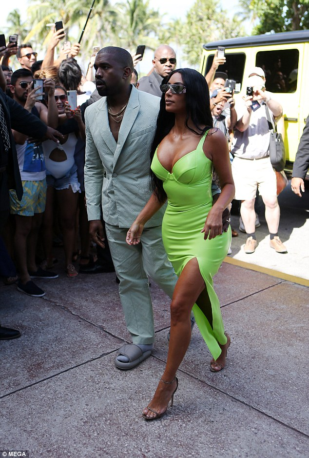 Kanye attended ceremony with his Keeping with The Kardashian star wife, who slipped her famously curvaceous figure into a neon bodycon gown, teamed with gold strappy shoes. Thank goodness they inseparable couple didn't choose to wear matching shoes!