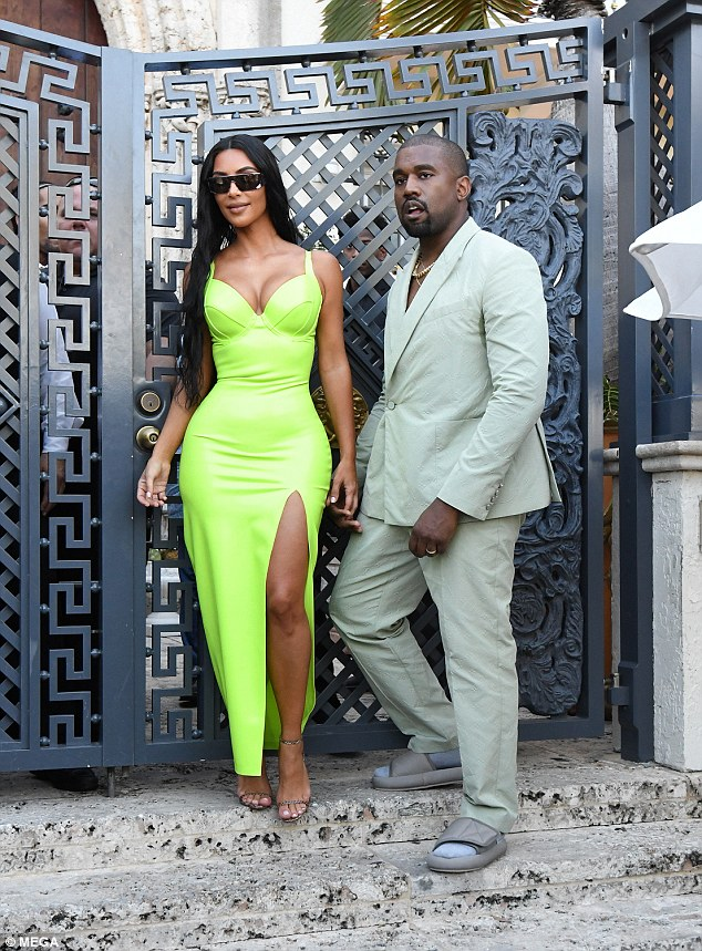 Kanye West couldn't help but draw in attention on his Yeezy slides with his mint suit to 2 Chainz' wedding in Miami on Saturday